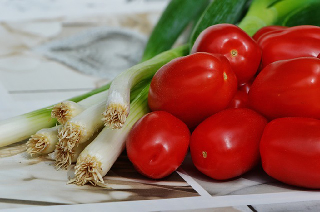 Luscious red Roma tomatoes and spring onions