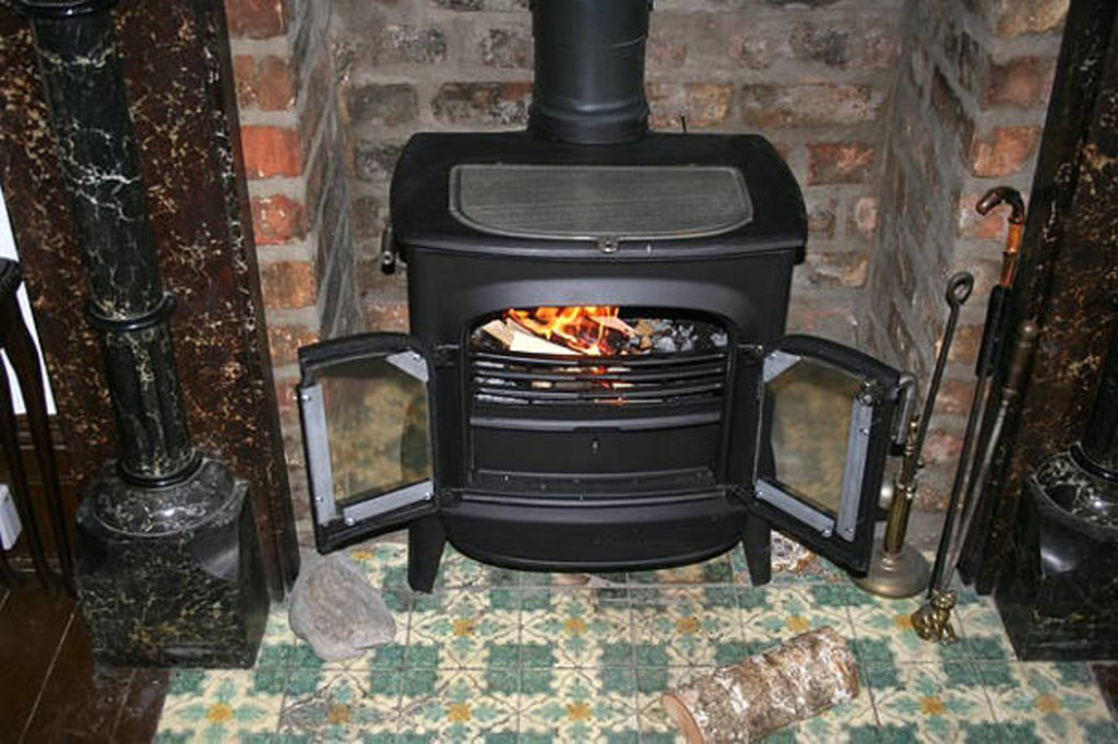 Wood stove with fire box larger than 2 cubic feet
